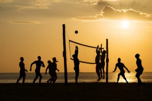 phuket, thailand - April 3, 2013: silhouette of beach Volleyball player on the beach and playground sand in sunset